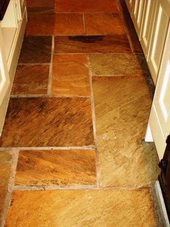 Picture shows how the sealer has brought out the colour in this Sandstone kitchen floor.