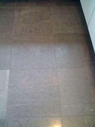 Rare black Honed Limestone floor before cleaning and sealing