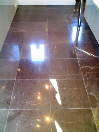 The same rare black Honed Limestone after being cleaned and sealed by Tile Doctor