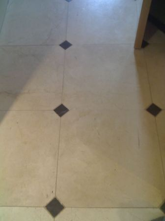 Crema Marfil polished Marble floor before renovation by Tile Doctor