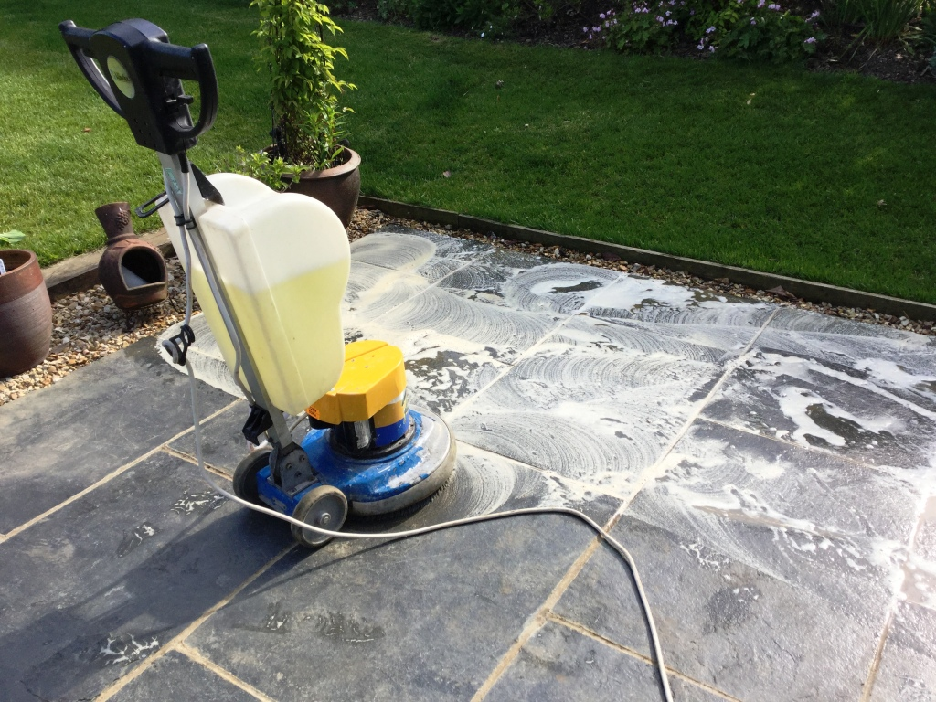 Black Limestone patio during cleaning in Walgrave