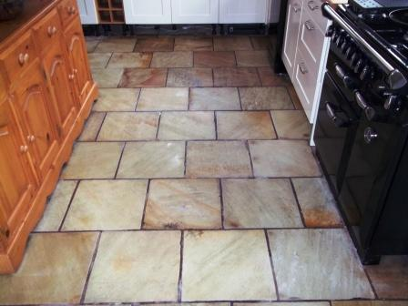 Picture shows how the sealer has brought out the colour in this Indian Sandstone kitchen floor.