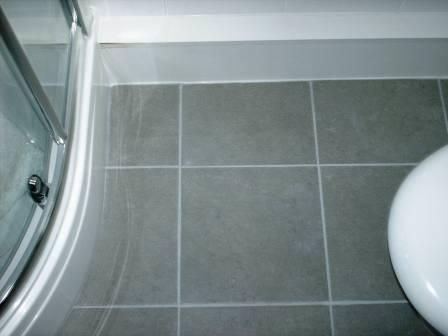 Click to Enlarge - After Picture - Grout Colour restored on a Ceramic Tiled Bathroom Floor by the Tile Doctor