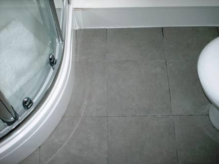 Click to Enlarge - Before Picture - Grout Colour restored on a Ceramic Tiled Bathroom Floor by the Tile Doctor