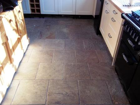 Picture shows Indian Sandstone kitchen floor before cleaning and sealing